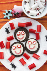 Smiling cookies with candies in Halloween festivities