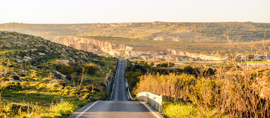Sunset over a long deserted road in Malta