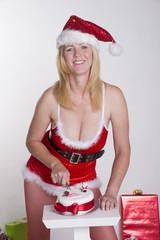 Woman in fancy dress cutting Christmas cake