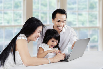 Asian family surfing internet