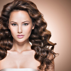Young beautiful caucasian woman with long brown curly hair