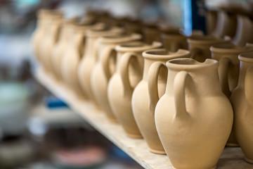 Ceramic dishware in pottery workshop