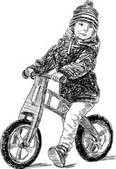 little boy on the bike