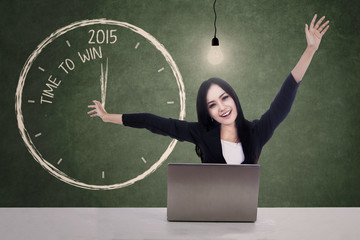 Businesswoman celebrate time to win in 2015