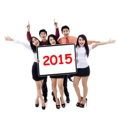 Cheerful business people hold number 2015