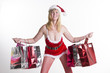 Woman in Santa outfit and shopping bags