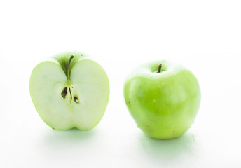 Two big green apples and half of apple on white background