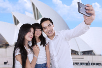 Family taking picture in sydney