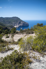 Landscape image of S'Aguila bay cove on Mediterranean island of