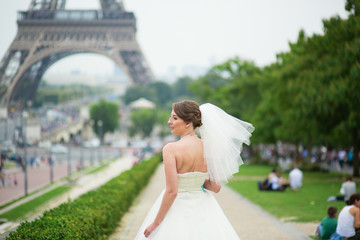 Happy young beautiful bride in Paris