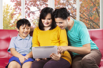 Hispanic family using digital tablet