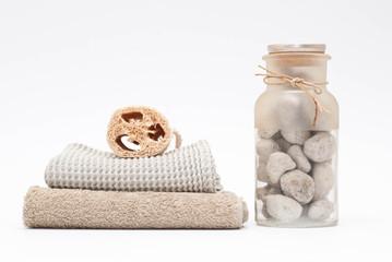 Asciugamani, spugna e pietra pomice