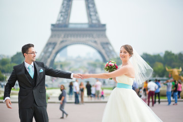 Happy just married couple in Paris