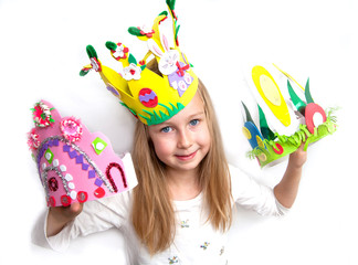 Little girl demonstrating her craft works and Easter bonnet