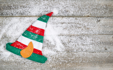 Christmas Elf Stocking on rustic wood with snow