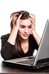 Woman working hard on laptop.