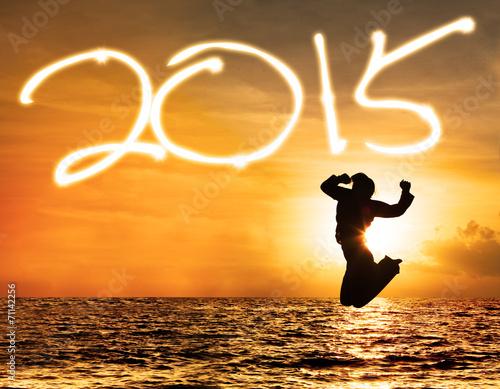 Leinwandbild Motiv Silhouette of girl with number 2015 in sunset