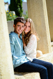 happy young couple of teenager first love together in summertime poster