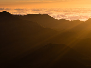 Beams of the rising sun over Haleakala volcanic crater on Maui