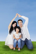 Two parents forming safety symbol