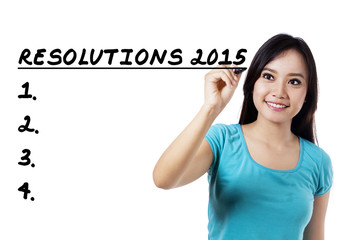 Woman make a list of her resolutions