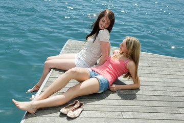 women on the berth at sunny vacation day