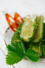 freshly-salted cucumbers on vintage enamel sieve