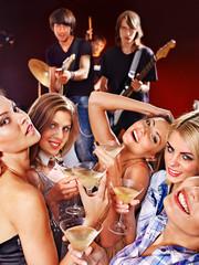 Woman on disco in night club.