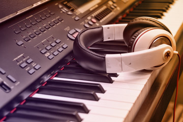 Piano keyboard and headphones