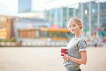 Young beautiful woman having her coffee break
