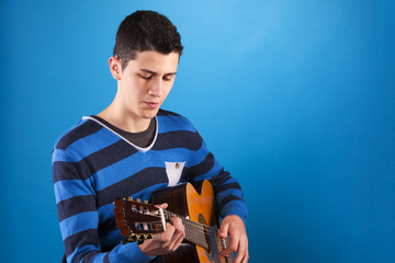 Teenager holding a classic guitar