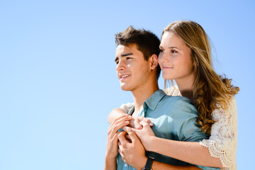 happy young couple teenager first love together in summertime
