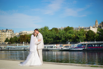 Just married couple on the Seine embankment