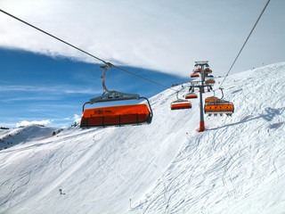Orange bulbs of chair-lift.