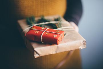 Woman holding modern Christmas present gift