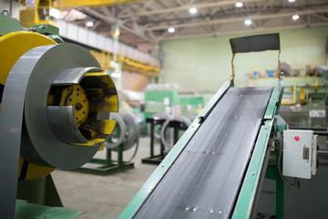 Transformer steel cutting machine at factory workshop background