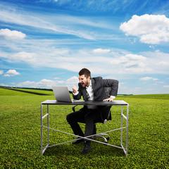man looking at laptop, screaming