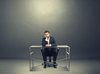 tired businessman sitting