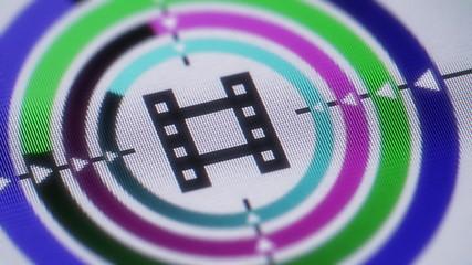Cinema icon on the screen. Looping.
