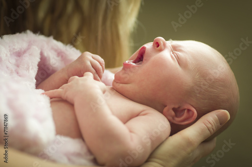 Hands of Mother Holding Her Newborn Baby Girl - 71147869