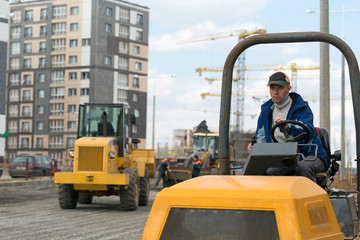 Industrial driver during road construction works