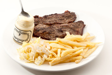 cooked steak with fries
