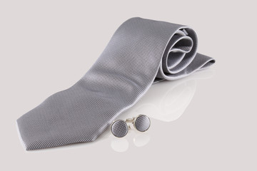 Tie with cuff links