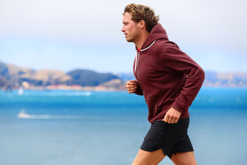 Runner athlete man running in sweatshirt