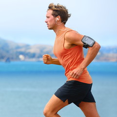 Running app on smartphone - male runner