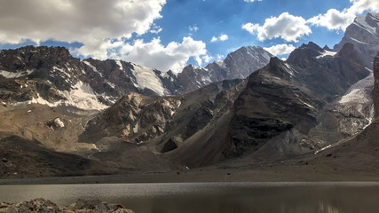 Slopes of mountains under clouds. TimeLapse. Pamir, Tajikistan