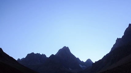 Slopes of mountains in the moonlight. TimeLapse. Pamir. UltraHD
