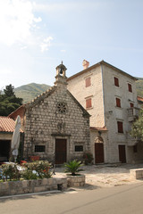 The Catholic Church and the house in a village in Montenegro