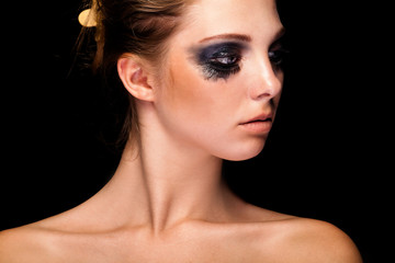 Beautiful young girl with crying black make up