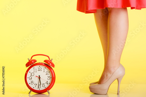 canvas print picture Sexy female legs in high heels and red clock.